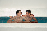 Couple relaxing in swimming pool together