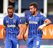 Sammy Moore of AFC Wimbledon and Matt Tubbs of AFC Wimbledon leave the pitch at half time during the Sky Bet League 2 match at Kenilworth Road, Luton<br /> Picture by David Horn/Focus Images Ltd +44 7545 970036<br /> 16/08/2014