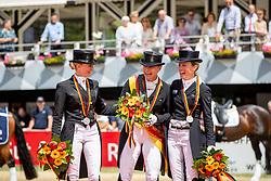 Bredow-Werndl Jessica von (GER), Werth Isabell (GER), Langehanenberg Helen (GER)<br /> Balve - Longines Optimum 2019<br /> Siegerehrung<br /> LONGINES Grosser Optimum Preis<br /> Deutsche Meisterschaft Dressur<br /> Grand Prix Kür<br /> 16. Juni 2019<br /> © www.sportfotos-lafrentz.de/Stefan Lafrentz