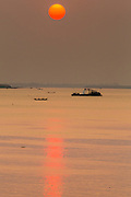 01 FEBRUARY 2013 - PHNOM PENH, CAMBODIA:  Sunrise on the Mekong River in Phnom Penh, Cambodia.     PHOTO BY JACK KURTZ