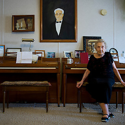 Olive Haffner uses these two pianos to teach lessons four times a week at her home in Moscow Mills, Mo. Haffner taught her first piano lesson 77 years ago when she was 19 years old. The painting is of her father, James Robert Shultz, who died in 1959.