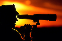 Bird watcher at sunset.