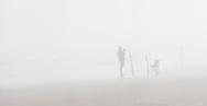People Fishing in Heavy Fog