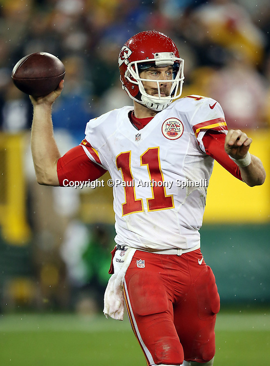 Kansas City Chiefs quarterback Alex Smith (11) throws a pass during the 2015 NFL week 3 regular season football game against the Green Bay Packers on Monday, Sept. 28, 2015 in Green Bay, Wis. The Packers won the game 38-28. (©Paul Anthony Spinelli)