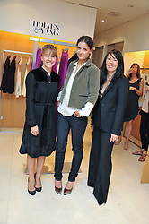 Left to right, HEATHER McQUARRIE, KATIE HOLMES and JEANNE YANG at a preview of the new Holmes & Yang fashion collection at Harvey Nichols, London on 6th July 2011.