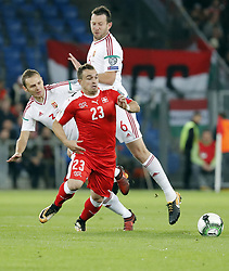 BASEL, Oct. 8, 2017  Switzerland's Xherdan Shaqiri (front) vies with Hungary's Mihaly Korhut (L) and Akos Elek during the FIFA World Cup 2018 Qualifiers Group B match between Switzerland and Hungary in Basel, Switzerland, Oct. 7, 2017. Switzerland won 5-2. (Credit Image: © Ruben Sprich/Xinhua via ZUMA Wire)