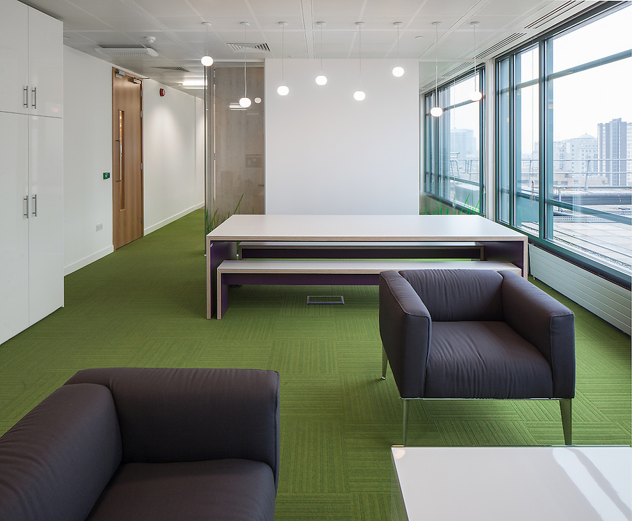 london office interior green carpet glass wall