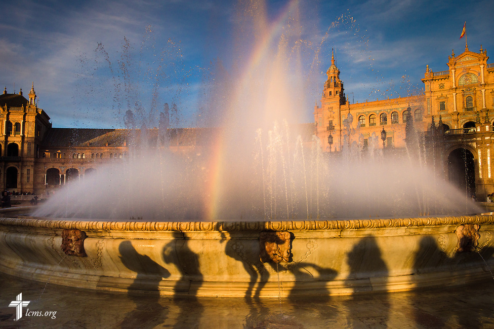 Tourists pose during sunset at the Plaza de España on Sunday, Nov. 6, 2016, in Seville, Spain.  LCMS Communications/Erik M. Lunsford