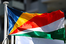 The flag of The Seychelles on a pole at the Commonwealth Games