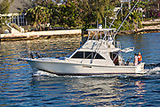 Sport fishing boat leaving Nassau Harbour, Nassau, Bahamas, Caribbean