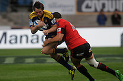 Highlanders Ben Smith Gets tackled by Sonny bill Williams of the Crusaders, Investec Super Rugby - Highlanders v Crusaders, 19 March 2011, Carisbrook Stadium, Dunedin, New Zealand.Photo: New Zealand. Photo: Richard Hood/www.photosport.co.nz