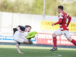 Falkirk's Conor McGrandles after tackle by Hamilton's Ziggy Gordon.<br /> Falkirk 1 v 1 Hamilton, Scottish Premiership play-off semi-final first leg, played 13/5/2014 at the Falkirk Stadium.