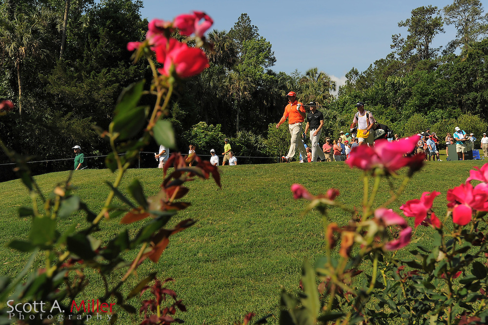 Sergio Garcia, in orange, and Chris Kirk walk off the eighth tee box during the third round of the Players Championship at the TPC Sawgrass on May 12, 2012 in Ponte Vedra, Fla. ..©2012 Scott A. Miller..