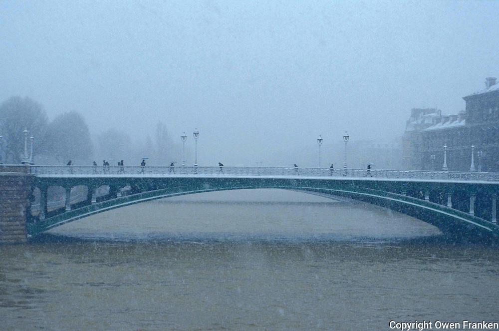 Paris bridge in the snow - Photograph by Owen Franken