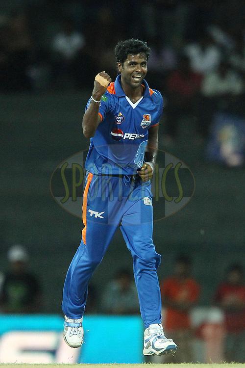 Shamindra Eranga celebrates the wicket of Hammad Azam during match 21 of the Sri Lankan Premier League between Uva Next and Nagenahiras held at the Premadasa Stadium in Colombo, Sri Lanka on the 27th August 2012. .Photo by Ron Gaunt/SPORTZPICS/SLPL