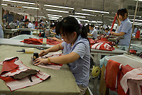 Young Chinese woman at work / Yingdak leather factory.