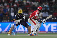 Akshar Patel of the Kings X1 Punjab gets stumped out by Robin Uthappa of the Kolkata Knight Riders during match 15 of the Pepsi Indian Premier League 2014 Season between The Kings XI Punjab and the Kolkata Knight Riders held at the Sheikh Zayed Stadium, Abu Dhabi, United Arab Emirates on the 26th April 2014<br /> <br /> Photo by Pal Pillai / IPL / SPORTZPICS