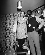"""14/07/1972<br /> 07/14/1972<br /> 14 July 1972<br /> Al """"Blue"""" Lewis at the Gaiety Theatre. Maureen Potter was well able to measure up the guest star who appeared unexpectedly on stage during her show at the Gaiety Theatre . But she had to use a chair to assist her level with the Towering big fight contender Al """"Blue"""" Lewis."""