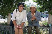 ULAN BATOR, MONGOLIA..08/21/2001.Woman and old man..(Photo by Heimo Aga)