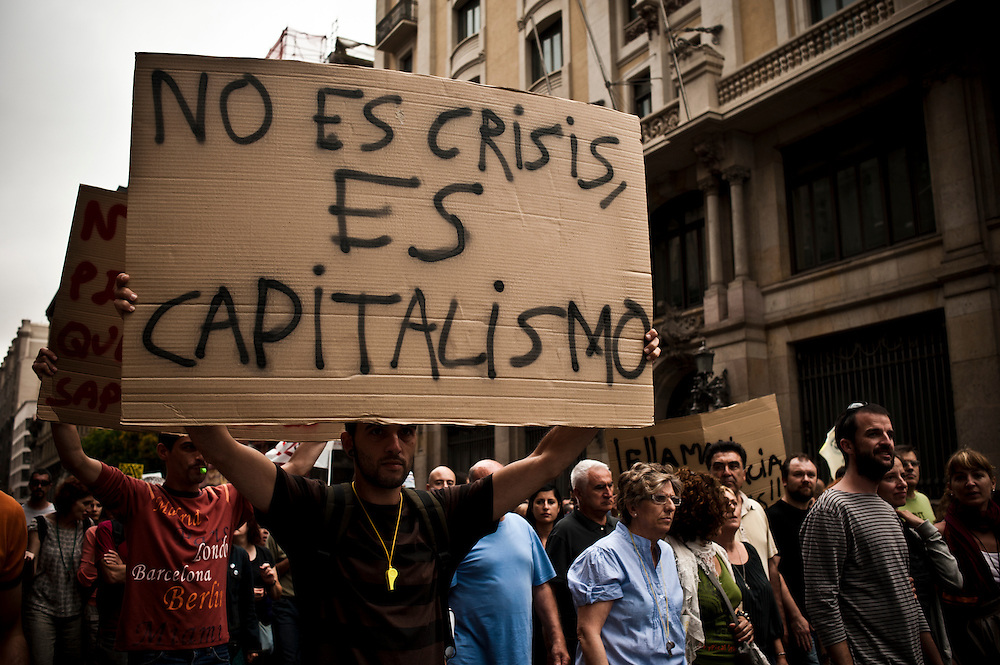 "Barcelona, Spain June 19th, 2011. Indignant protest. On the banner : ""Is not crisis, is capitalism"""