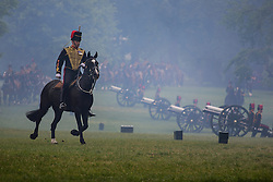 © licensed to London News Pictures. London, UK 10/06/2013. The King's Troop Royal Horse Artillery marching in Green Park after firing a 41 gun salute in honour of the Duke of Edinburgh's 92nd birthday. Photo credit: Tolga Akmen/LNP