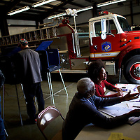 "Walterboro, SC - FEBRUARY 20:  Erica Levine, 20, a poll manager at the Colleton County Fire & Rescue polling precinct registers a voter in Walterboro, SC, on February 20, 2016.  Statewide voters will cast ballots today in the South Carolina Republican Presidential Primary, the ""first in the south.""  (Photo by Mark Makela/Getty Images)"