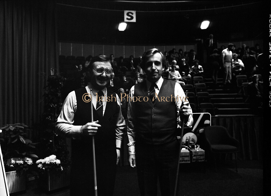 The Benson and Hedges .Irish Masters Snooker..1984..28.03.1984..03.28.1984..28th March 1984..The championship was held at Goffs,Co Kildare. All the top names in snooker took part..Steve Davis,Jimmy White,Eddie Charlton,.Tony Knowles,Dennis Taylor,Tony Meo,.Alex Higgins,Ray Reardon,.Cliff Thorburn,Terry Griffiths,.Bill Werbeniuk and Eugene Hughes..The eventual winner was Steve Davis who beat Terry Griffiths 9 -1 in the final..Image taken as Dennis Taylor  and Terry Griffiths pose for the cameras.