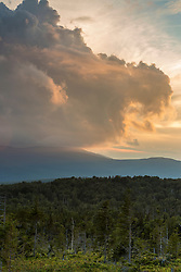 Summer storm clouds form on Saddleback Mountain as seen from a logging road on Farmer Mountain in Mount Abram Township, Maine