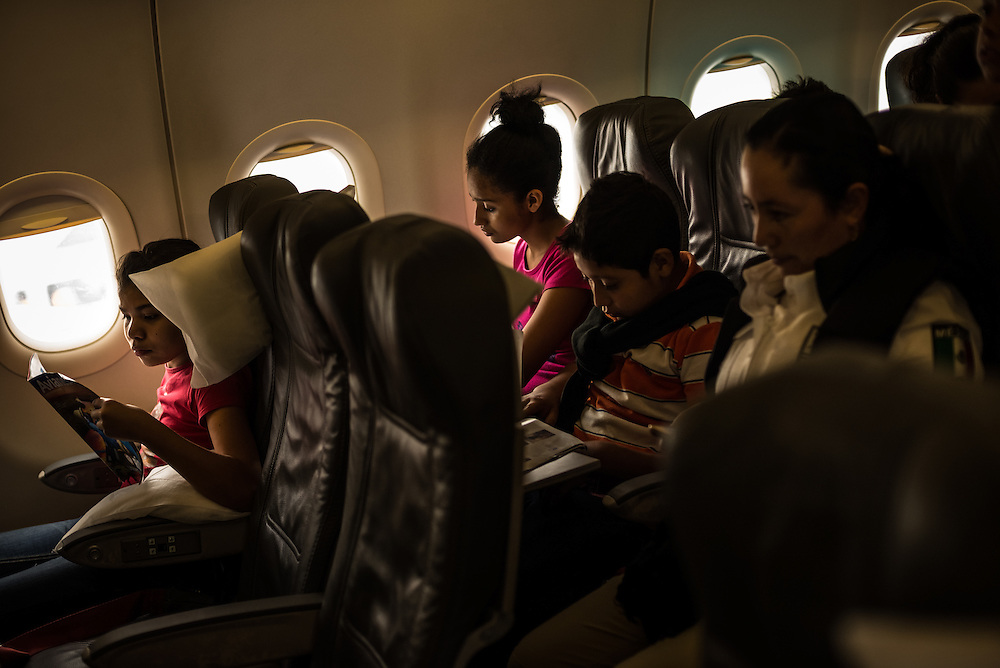 MEXICO CITY, MEXICO - JULY 9, 2014:  Mexican authorities accompany deported minors back to El Salvador on a commercial flight to San Salvador. Last year, Mexico deported 89,000 Central Americans, including 9,000 children, the bulk of the returnees from Honduras, Guatemala and El Salvador, officials have said, while in the fiscal year that ended last September the United States sent back 106,420 from those countries. Honduran officials said Mexico has returned 6,000 minors this year, a 25 percent increase over the same period last year.  PHOTO: Meridith Kohut for The New York Times