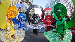"© Licensed to London News Pictures. 18/03/2012. London, England. The London carnival group ""Mahogan"" sporting Olympic rings. London celebrates St. Patrick's Day with a parade and festival. Photo credit: Bettina Strenske/LNP"