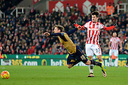Stoke City Striker Bojan Krkic fouls Arsenal defender Nacho Monreal during the Barclays Premier League match between Stoke City and Arsenal at the Britannia Stadium, Stoke-on-Trent, England on 17 January 2016. Photo by Alan Franklin.