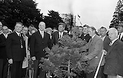 President John F. Kennedy attends a Garden Party at Áras an Uachtarain, Dublin, Ireland.  Kennedy plants a Californian Redwood in the grounds of the residence, watched by President de Valera and Mr. Frank Aiken, Minister for External Affairs (left)..27.06.1963.<br />