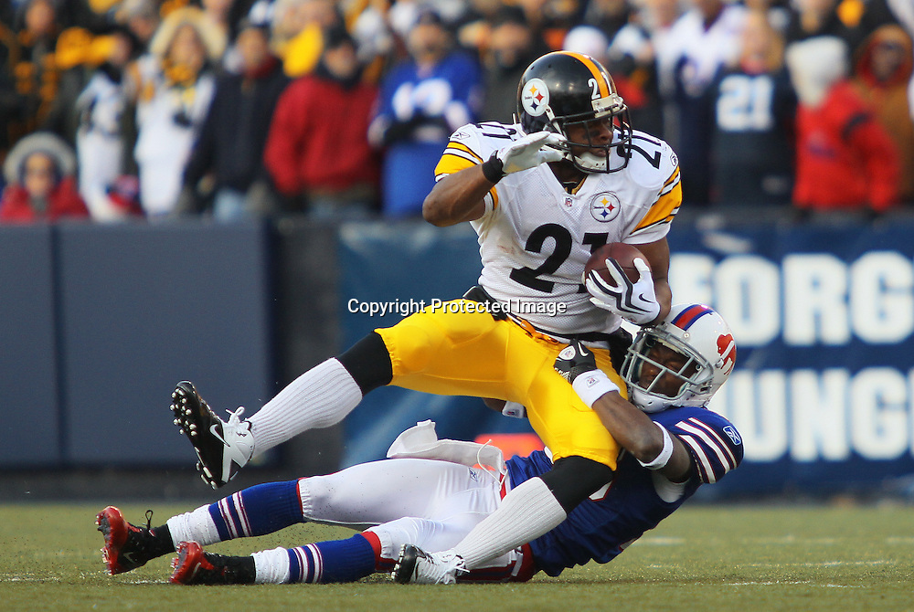 28 November 2010: Pittsburgh Steelers running back Mewelde Moore (21) is tackled by Buffalo Bills cornerback Leodis McKelvin (28) during a game against the Buffalo Bills at Ralph Wilson Stadium in Orchard Park, NY.