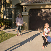ROYAL PALM BEACH, FLORIDA, MARCH 15, 2017<br /> Cynthia Greaux shoots around a basketball with her children; Tyler, 14, and Chloe, 8, in their driveway. Greaux is able to use vouchers to pay for their enrollment at a private school that specializes in educating children with dyslexia.<br /> (Photo by Angel Valentin/Freelance)