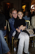 Louise Adams, Victoria Beckham's sister and child. Maria Grachvogel fashion show. 17 September 2001. © Copyright Photograph by Dafydd Jones 66 Stockwell Park Rd. London SW9 0DA Tel 020 7733 0108 www.dafjones.com