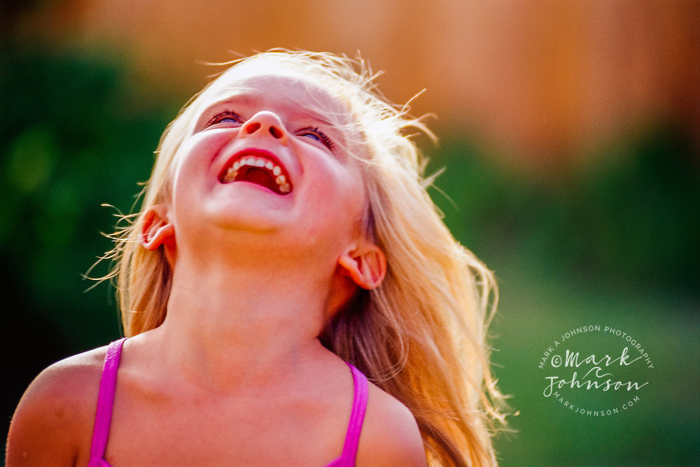 Girl Laughing and Tilting Head Back
