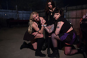 ]The Prettiots (Kay Kasparhauser, Rachel Trachtenburg and Lulu Prat) pose for a portrait during 35 Denton at Rubber Gloves in Denton, Texas on March 15, 2015. (Cooper Neill for The New York Times)