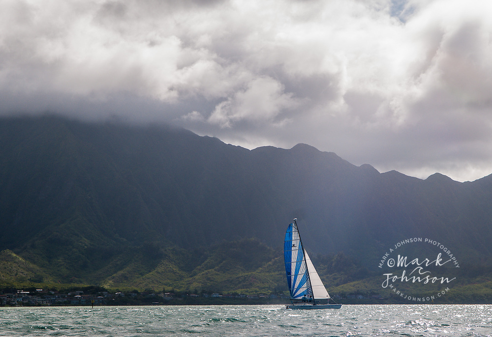 Sailing in Kaneohe Bay, Koola Mountains in the background, Oahu, Hawaii