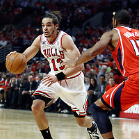 10 May 2011: Chicago Bulls center Joakim Noah (13) drives past Atlanta Hawks center Al Horford (15) during the Chicago Bulls 95-83 victory over the Atlanta Hawks, during game 5 of the Eastern Conference semi finals at the United Center, Chicago, Illinois, USA.