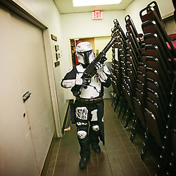 Kyle Green | The Roanoke Times<br /> March 01, 2009 - Cord Wartman of The Mandalorian Mercs patrols a kitchen hallway of the Holiday Inn in Roanoke, Virginia during the 17th annual SheVaCon science fiction and fantasy convention. The Mandalorian Mercs Costume Club is a Star Wars related Mandalorian Costume organization. The 200 member Mandalorain Mercs have 18 chapters in 6 countries around the world.