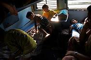Children play in the non-a/c sleeper class berths on the Himsagar Express 6318 going from Jammu Tawi station to Kanyakumari on 7th July 2009.. .6318 / Himsagar Express, India's longest single train journey, spanning 3720 kms, going from the mountains (Hima) to the seas (Sagar), from Jammu and Kashmir state of the Indian Himalayas to Kanyakumari, which is the southern most tip of India...Photo by Suzanne Lee / for The National