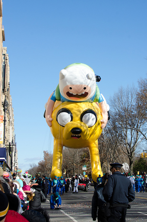 NEW YORK, NY, USA, Nov. 28, 2013. A balloon featuring Finn and jake from Cartoon Network's Adventuretime show moves down Central Park West during the 87th Annual Macy's Thanksgiving Day Parade.