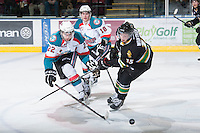 KELOWNA, CANADA - JANUARY 26: Cody Fowlie #18and MacKenzie Johnston #22 of the Kelowna Rockets block the pass and check Mike Winther #15 of the Prince Albert Raiders at the Kelowna Rockets on January 26, 2013 at Prospera Place in Kelowna, British Columbia, Canada (Photo by Marissa Baecker/Shoot the Breeze) *** Local Caption ***
