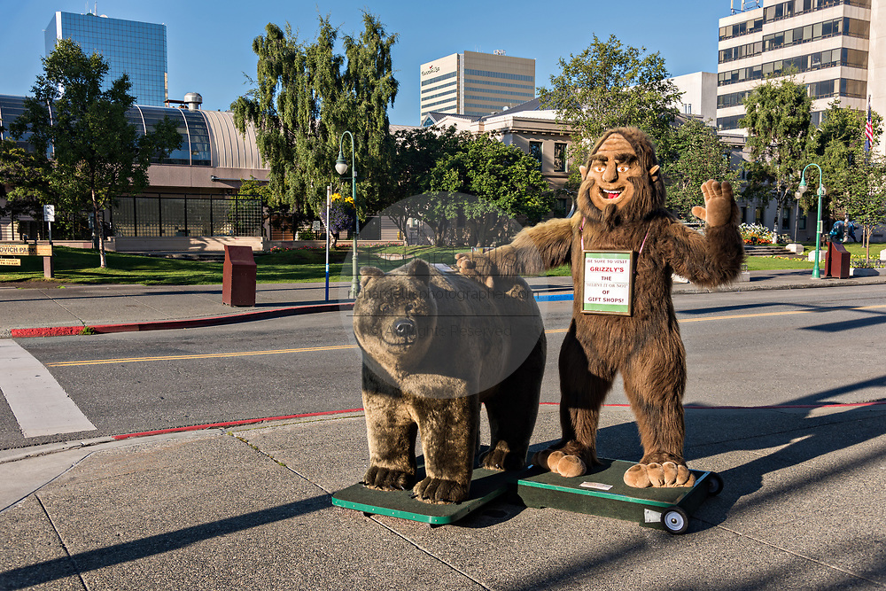 A giant stuffed bear and Bigfoot display outside a tourist shop along 4th Avenue in downtown Anchorage, Alaska.