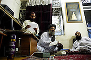 Abdul Raheed Gahzi, head of the Islamic Madrasas, Jamia Faridya (for boys) and Jamia Hafsa (for girls), sits with students in his office in Islamabad, Pakistan on Thursday Aug. 3, 2006. Every year the Taliban train recruits for jihad, or Holy struggle, against the United States forces in Afghanistan.
