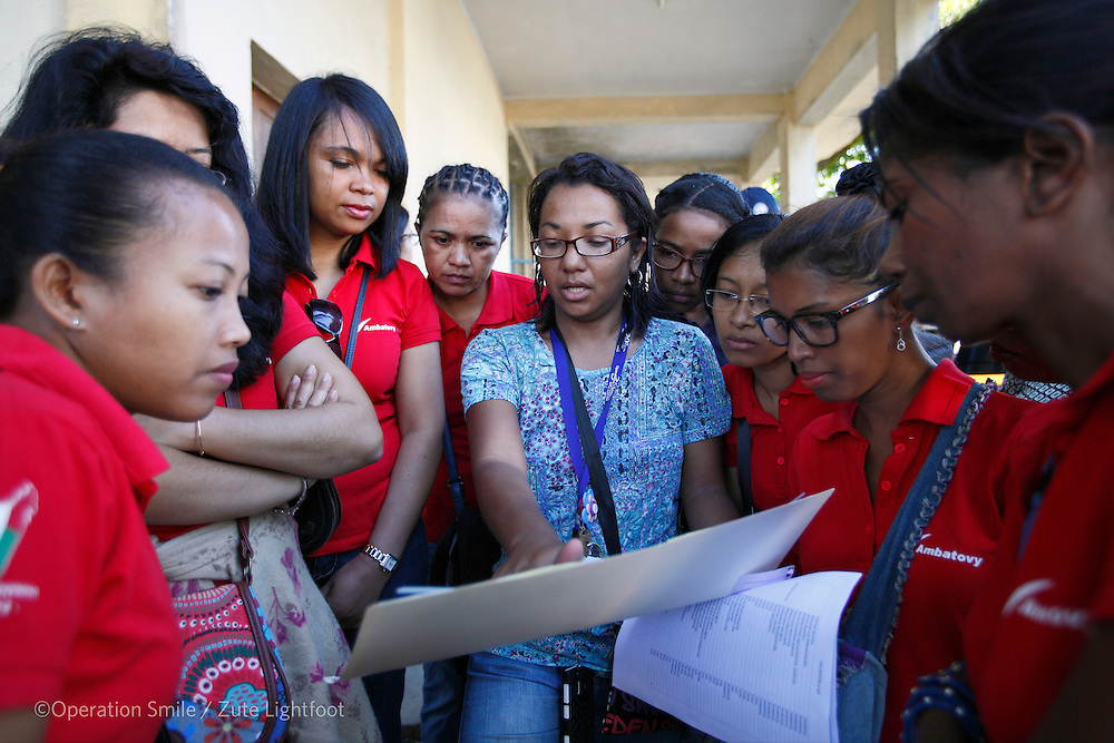 In-Country Program Officer Mamy Ramamonjisoa organises volunteers for screening during Operations Smile's 2015 mission to Tamatave at Tamatave General Hospital. Antsirabe Clinic Project sponsored by the Swedish Postal Code lottery. Madagascar. September 2015.<br /> (Operation Smile - Photographer Zute Lightfoot)