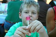 boy holding lolly pop