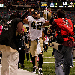 2009 October 04: New Orleans Saints safety Darren Sharper (42) celebrates as he walks off the field following a 24-10 win by the New Orleans Saints over the New York Jets at the Louisiana Superdome in New Orleans, Louisiana.