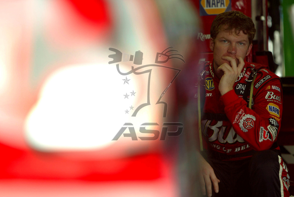 Dale Earnhardt, jr. ponders as he waits for his crew to make changes during a practice session for the Coca-Cola 600 NASCAR Winston Cup race at the Lowe's Motor Speedway in Concord, North Carolina.