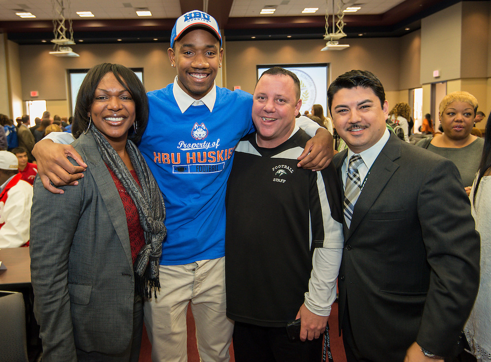 Austin's Taaron Timmons (HBU) poses for a photograph with family and staff during a National Signing Day ceremony at the Region 4 Education Center, February 5, 2014.